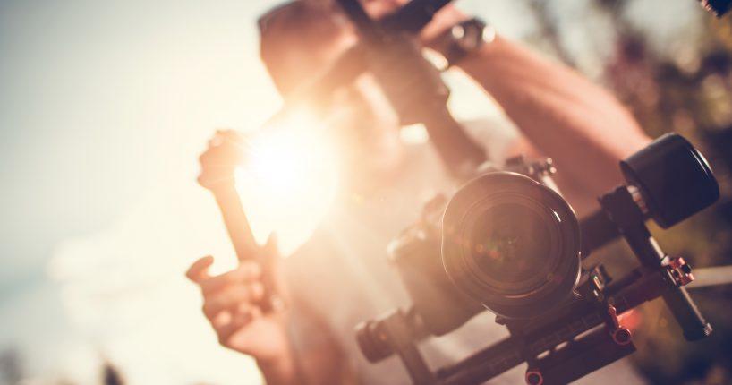 Camera Gimbal DSLR Video Production. Pro Video Stabilization. Video Maker Taking Shoots Using Pro Equipment.